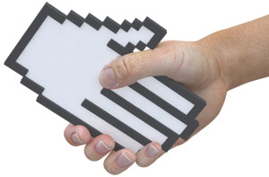 A hand shape pixel cursor shake hands with a 3D user in a tech friendly handshake as man and computer team up.